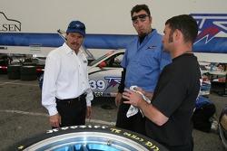 Kevin Buckler talks with TRG team members