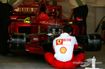 A mechanic works on a Scuderia Ferrari, F2007