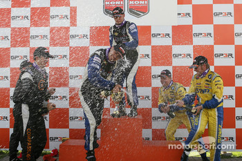 Podium: champagne for Kuno Wittmer, Nick Wittmer, Karl Thomson, Billy Johnson, Trevor Hopwood and Adam Burrows