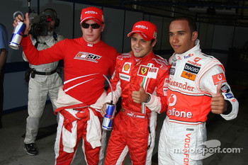 Pole winner Felipe Massa celebrates with Lewis Hamilton and Kimi Raikkonen
