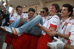 Race winner Felipe Massa celebrates with Scuderia Ferrari team members