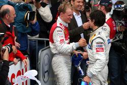 Mattias Ekström is congratulated by Bruno Spengler