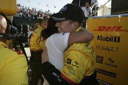 Pole winner Ryan Briscoe celebrates with Penske Racing team members