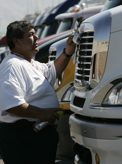 A team member cleans up a truck