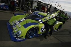 Krohn Racing team members push the car to pitlane