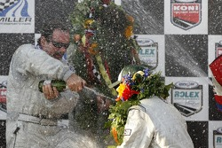 DP podium: champagne for Jim Matthews, Marc Goossens and Ryan Hunter-Reay