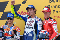 Podium: race winner Valentino Rossi, second place Dani Pedrosa, third place Casey Stoner