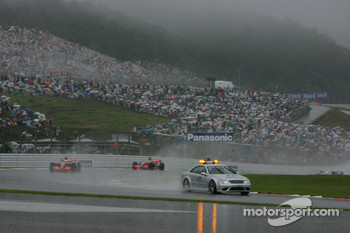 The F1 Safety Car leads Lewis Hamilton, McLaren Mercedes, MP4-22 and Fernando Alonso, McLaren Mercedes, MP4-22