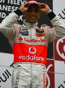 Podium: race winner Lewis Hamilton celebrates