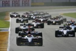 Timo Glock leads the field on the opening lap of the race