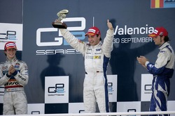 Timo Glock celebrates winning the 2007 GP2 Series Championship on the podium with Javier Villa and Andy Soucek