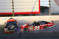 Chase contenders Carl Edwards and Tony Stewart grind to a halt after crashing in turn 3