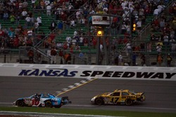 Greg Biffle takes a controversial checkered flag to win the LifeLock 400