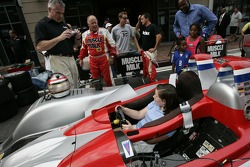 Petit Preview Party at Atlantic Station: a young fan tries the Team Cytosport Lola B06/14 AER while Greg Pickett looks on