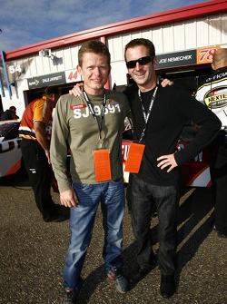 American Le Mans Series Penske Racing drivers Emmanuel Collard and Romain Dumas visit the garage area after their race at Road Atlanta on Saturday