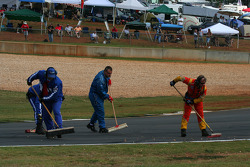 Corner workers clean up after GT qualifying
