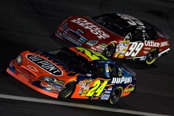 Jeff Gordon dives under Carl Edwards