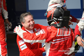 Race winner and 2007 World Champion Kimi Raikkonen celebrates with Jean Todt