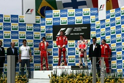 Podium: race winner and 2007 World Champion Kimi Raikkonen, second place Felipe Massa, third place Fernando Alonso