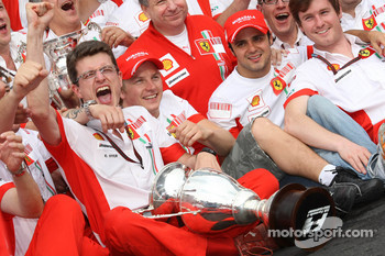 Ferrari team celebrations: race winner and 2007 World Champion Kimi Raikkonen celebrates with Felipe Massa, Jean Todt, Chris Dyer and Ferrari team members