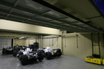 Williams F1 Team and BMW Sauber F1 Team cars still in the parc ferme for investigation