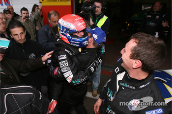 FIA GT1 drivers 2007 champion Thomas Biagi celebrates with Michael Bartels