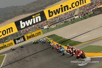 Casey Stoner leads Dani Pedrosa and the rest of the field