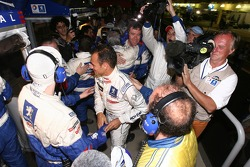 Stéphane Sarrazin celebrates 2007 Le Mans Series championship with Peugeot Total team members