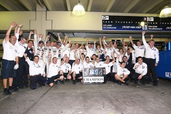 2007 Le Mans Series champions Pedro Lamy and Stéphane Sarrazin, and race winners Marc Gene and Nicolas Minassian celebrate with Peugeot Total team members