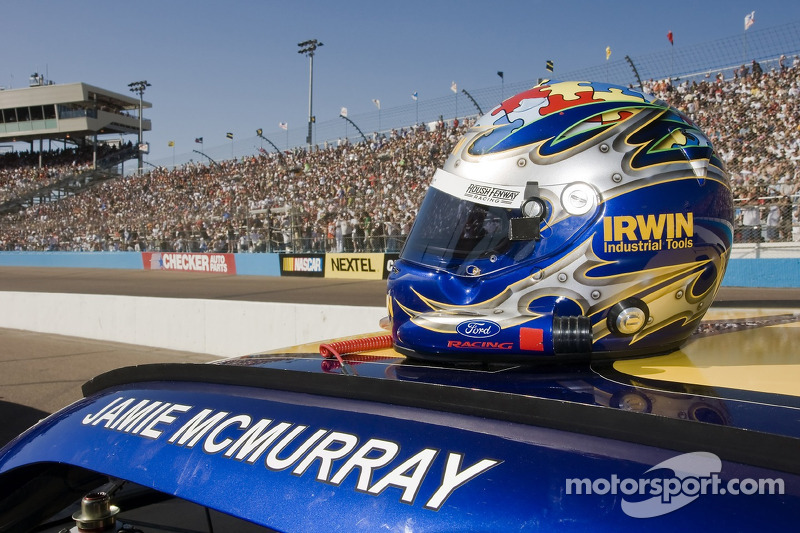 Jamie McMurray's helmet sits atop his car