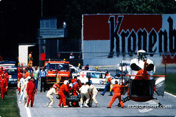 The fatal crash of Ayrton Senna at Tamburello: Ayrton Senna is brought to the safety helicopter