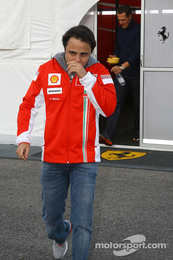 Felipe Massa, Scuderia Ferrari arrives with Michael Schumacher, Test Driver, Scuderia Ferrari, following