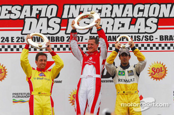 Podium: race winner Michael Schumacher with Luciano Burti and Lucas Di Grassi