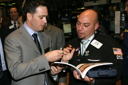 Jimmie Johnson, the 2007 NASCAR NEXTEL Cup Series Champion, signs autographs during a tour of the New York Stock Exchange