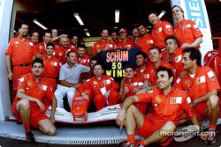 Michael Schumacher celebrating his 50th Grand Prix win with Team Ferrari