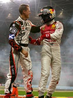 Race of Champions winner Mattias Ekström celebrates with second place Michael Schumacher