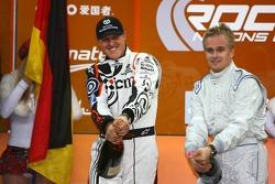 Podium: Heikki Kovalainen and Michael Schumacher