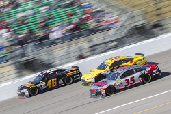 Michael Annett, HScott Motorsports Chevrolet and Cole Whitt, Front Row Motorsports Ford