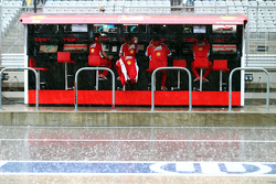 The Ferrari pit gantry during heavy rain that cancelled the second practice session