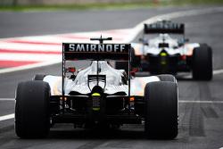 Nico Hulkenberg, Sahara Force India F1 VJM08 follows team mate Sergio Perez, Sahara Force India F1 VJM08 out of the pits