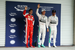 Polesitter Nico Rosberg, Mercedes AMG F1 and third place Sebastian Vettel, Ferrari and second place Lewis Hamilton, Mercedes AMG F1 Team