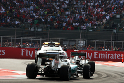 Nico Rosberg, Mercedes AMG F1 W06 leads Lewis Hamilton, Mercedes AMG F1 W06 behind the FIA Safety Car