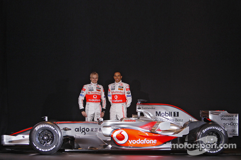 Heikki Kovalainen and Lewis Hamilton pose with the new McLaren Mercedes MP4-23