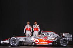 Heikki Kovalainen and Lewis Hamilton pose with the new McLaren Mercedes MP4-23