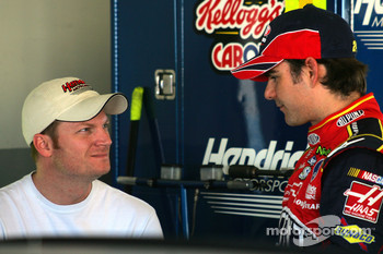 Dale Earnhardt Jr. talks with teammate Jeff Gordon