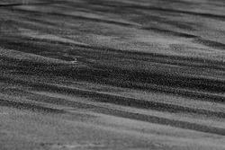 Tire marks on pit lane