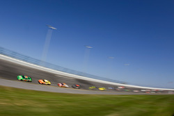 Kyle Busch leads the field into turn 4