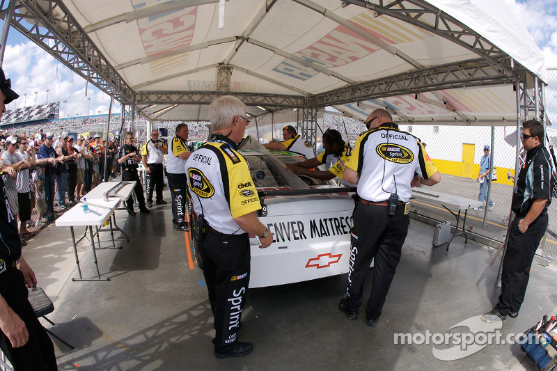 NASCAR officials at work at tech inspection