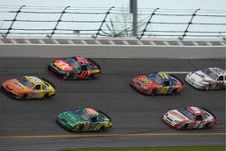 Carl Edwards and Tony Stewart lead a group of cars