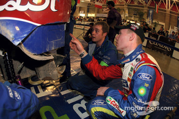 Jari-Matti Latvala shows one of the M-Sport expert technicians what work needs carrying out on the back of his Ford Focus RS WRC